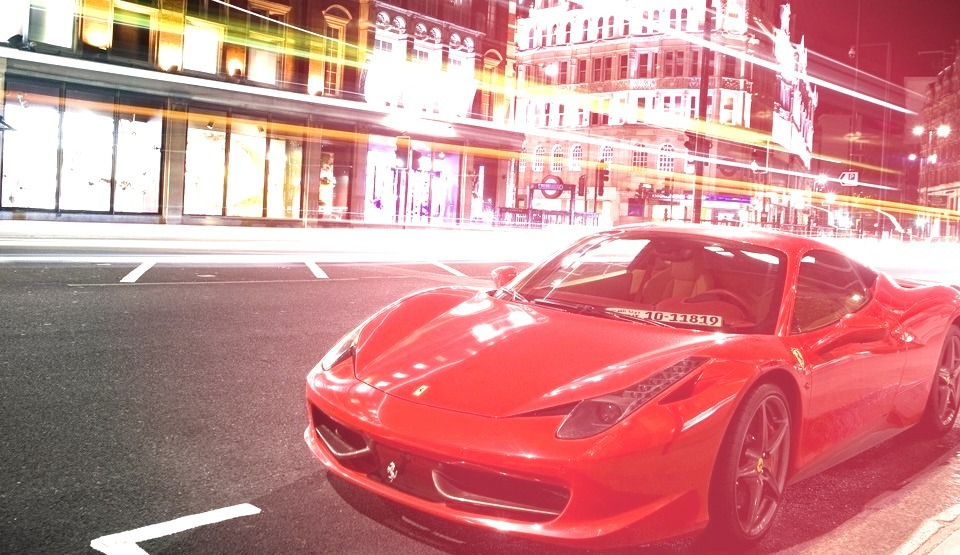 Red Ferrari Parked on the Street