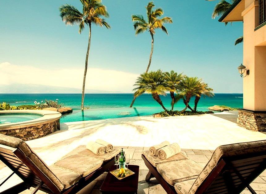 Luxury Outdoor Patio Overlooking Clear Blue Waterwww.DiscoverLavish.com