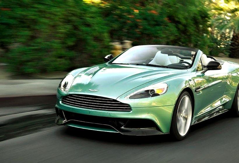Green Aston Martin Convertible Speeding Down the Road
